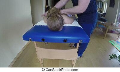 masseur massage woman - Professional masseur man hand...