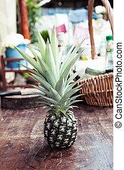 pineapple on wood table closeup