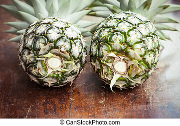 Closeup of pineapple on wooden background