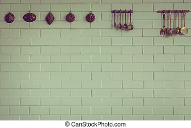 Vintage kitchen spoon and fork hanging on wall Filtered...