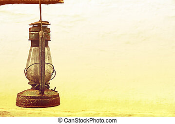 Vintage old kerosene lamp outdoors taken closeupToned image...