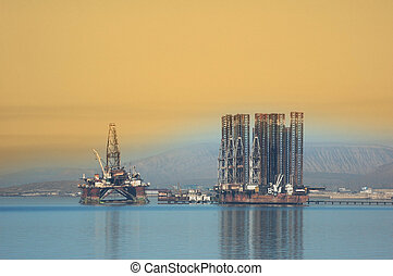 Two offshore rigs at Caspian shore near Baku - Two offshore...