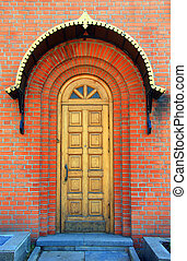 architectural background of bricks and wooden door