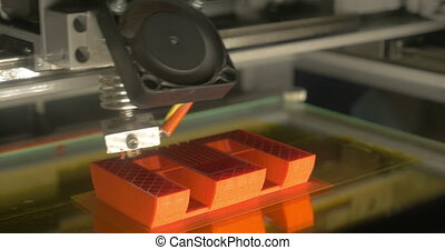 Accurate 3D printing of letter E - Close-up shot of 3D...