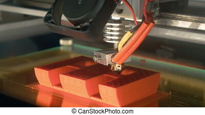 3D printing of letter E - Close-up shot of working 3D...