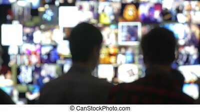 People in Front of Virtual Wall with Moving Pictures -...