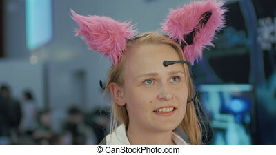 Woman in Brainwave Controlled Cat Ears - Young woman is...