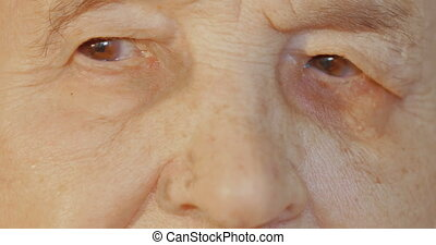 Elderly womans face with tired expression - Close-up shot of...