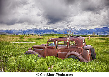 Rusting Jalopy On Montana Farm - An old car rusts away on a...