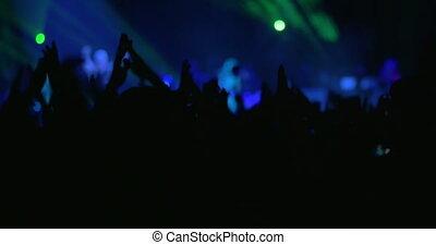 People enjoying the performance of favorite singer