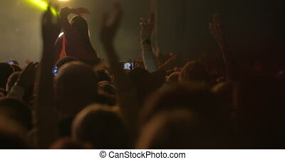 Man Taking Photos of the Concert on Smartphone - Man is...