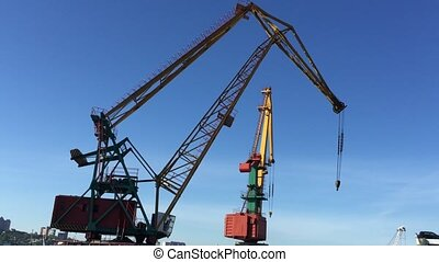 Crane at sea port works
