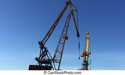 Crane at sea port works.
