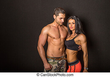 Fit couple - A fit and sporty couple on a black background.
