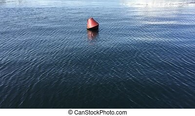 Lonely buoy in the wide sea