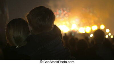 Mother and little son watching fireworks - Mother holding...