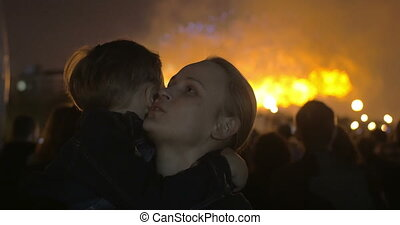 Son and mother on firework show