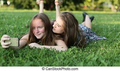 Two young girls best friends lying