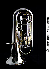 A brass gold bass tuba euphonium against a black background...