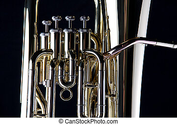 Bass Tuba Euphonium Isolated On Black - A brass gold bass...