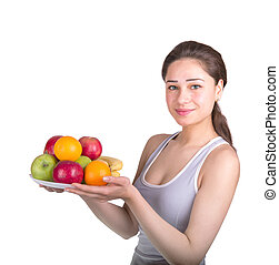 sports girl holding a bowl of fruit