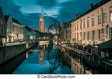 Canal Dijver and a Church of Our Lady in Bruges - Scenic...