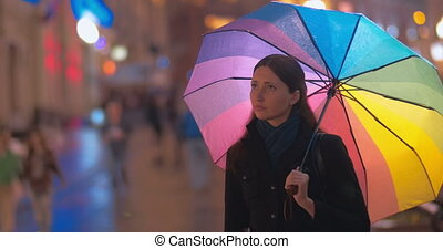 Two women friends meeting in rainy evening - Young female...