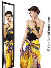 Woman Looking at Mirror
