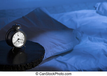 Insomnia - Alarm clock with empty bed and moon-light effect....