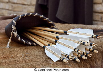 quiver - ancient quiver with arrows over the table