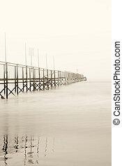 dock shrouded by the fog