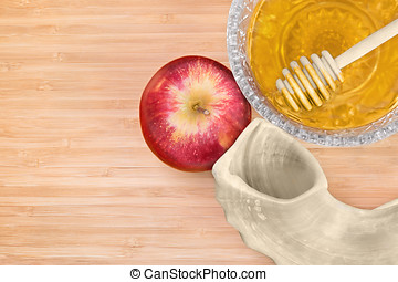 Rosh Hashana shofar, whole red apple, glass honey bowl with...