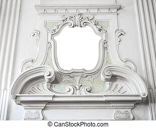 the ornament of a fireplace hood in a neo classical villa...