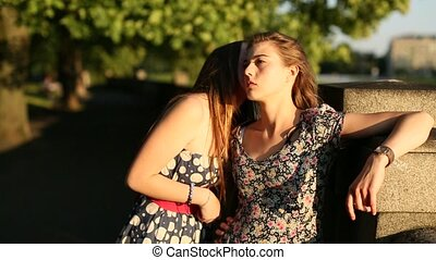 Two best friends teenage girls foolishly fun talking on the...