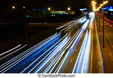 Night highway with car traffic and blurry lights – long...