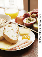 Continental Breakfast With Fruits Cereal and Bread