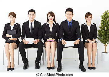 happy business people sitting on the chairs