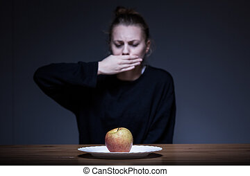 Woman refusing to eat - Woman with anorexia refusing to eat...