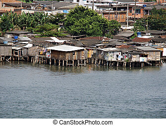 poor houses built out over the water in brazil - poor houses...