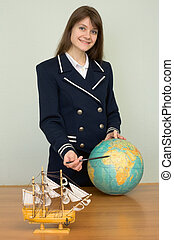 Woman in sea uniform with globe at travel agency office