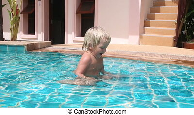 little girl plays on bottom of pool and scrambles out -...
