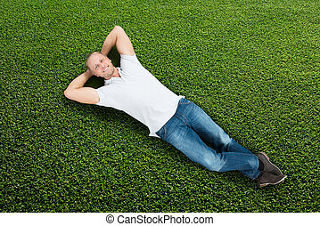 Man Lying On Grass - Young Happy Man Lying On Green Grass