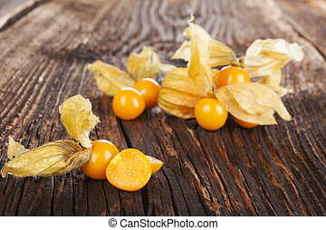 Physalis - Physalis, groundcherriesl on brown textured aged...