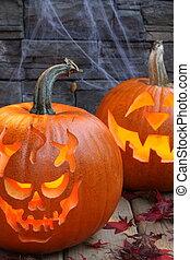 Carved pumpkins, 2 brightly lit - Carved pumpkins, 2 lit...