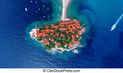An aerial view of Sveti Stefan the resort on its peninsula...
