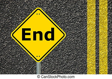 the end concept with warning roadsign in yellow...