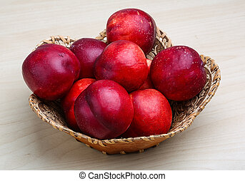 Nectarines - Fresh ripe Nectarines in the wooden plate