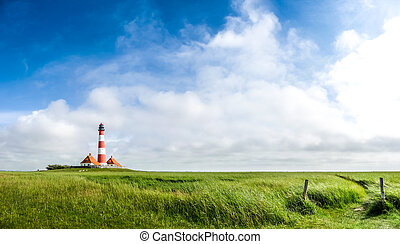 Beautiful landscape with famous Westerheversand lighthouse...