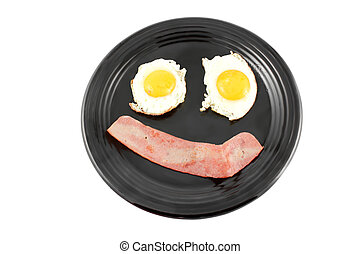 Bacon and eggs smile - Bacon and fried eggs for breakfast in...