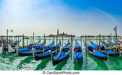 Beautiful view of traditional Gondolas on Canal Grande with San Giorgio Maggiore church in the background at morning, San Marco, Venice, Italy